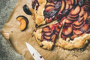 Flat-lay of plum galetta sweet cake