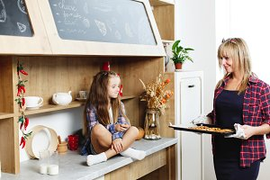 Mom and daughter on a kitchen