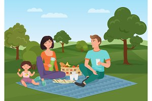 Happy family with kid on a picnic