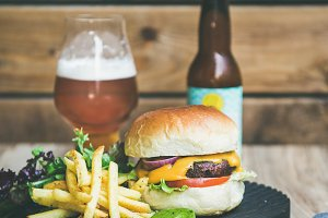 Classic burger dinner with beer and