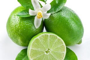 Ripe lime fruits on the white backgr