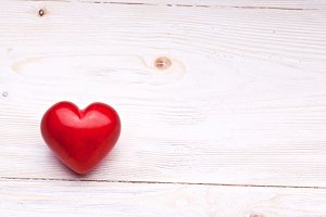 Valentines Day. Red heart on a woode