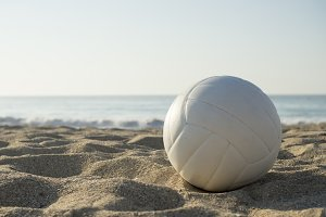 white ball on sand beach