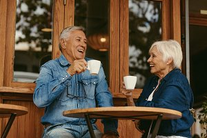 Smiling senior couple drinking