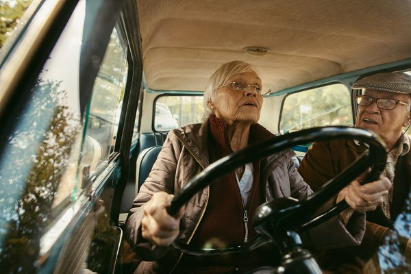 People Stock Photos: Jacob Lund - Elderly couple driving