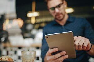 Entrepreneur using a tablet computer