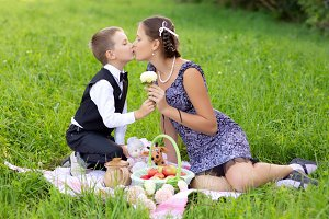 Little boy and teen age girl having