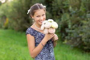 beautiful teen age girl holding