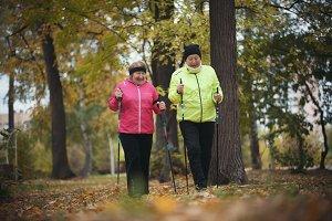 Old women walking in an autumn park
