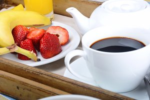 Breakfast tray with coffee and fruit