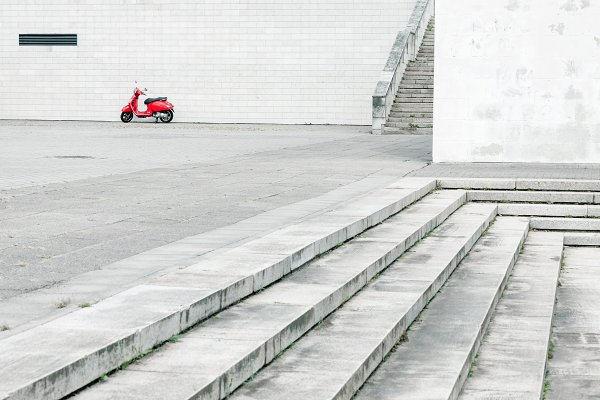 Transportation Stock Photos: BOOCYS - Red scooter against white wall