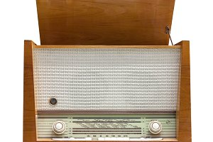 Old vintage radio isolated on white