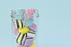 Colored chewing sweets in glass jar