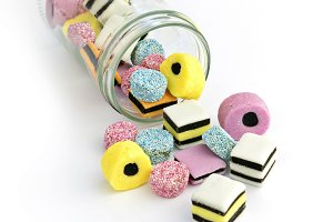 Small glass jar with colored candy