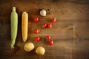Fresh vegetables on wooden boards.