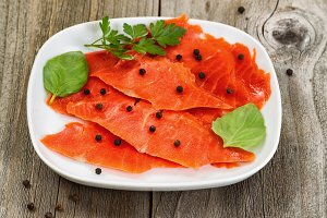 Cold smoked red salmon in plate