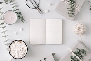 Blank notebook among gift boxes