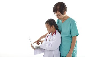 woman and girl in doctor costumes ch
