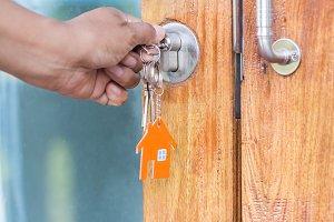 hands locking the door with key