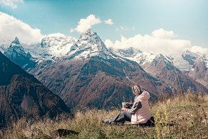 Girl travel in mountains alone, drin