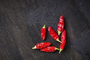 Red chili pepper on dark background