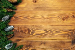 Fir branches on the wooden board