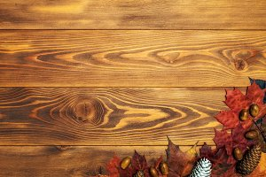 Maple leaves on the wooden board