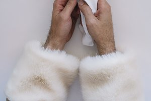 The hands of Santa Claus holding the