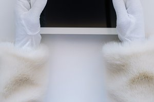 Santa Claus hands holding a tablet