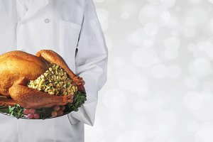 Chef holding a Thanksgiving turkey o
