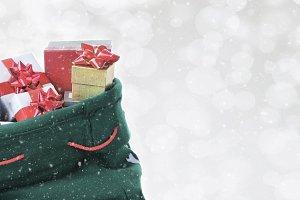 Santa Claus toy bag on a silver boke
