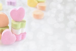 Pastel Candy hearts on a silver boke