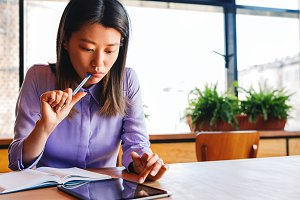 Young businesswoman sitting at table