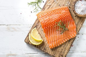 Salmon fillet with  spices on whit