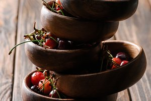 stacked bowls with fresh ripe cherri
