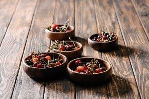 fresh ripe sweet cherries in bowls o