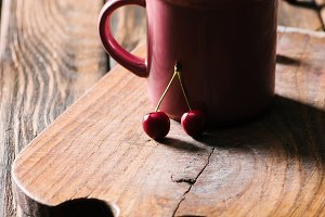 healthy tasty cherries in pink cup o