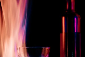 close up view of flame, empty glass