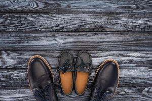 top view of father and kid shoes on