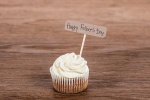 tasty cupcake with Happy fathers day