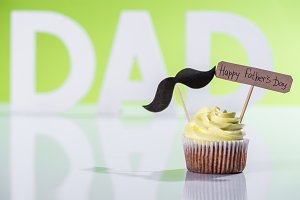 creamy cupcake with mustache sign an