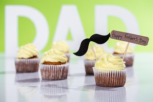 creamy cupcakes with mustache sign a
