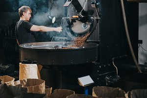 Man controlling process of roasting