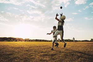 American football player catching a