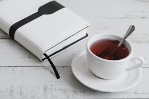 Red hibiscus tea and a book
