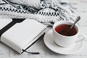 Red hibiscus tea, book and blanket
