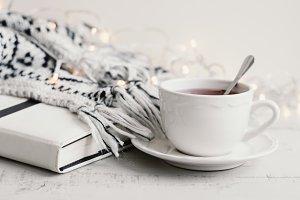 Tea, book, lights and blanket