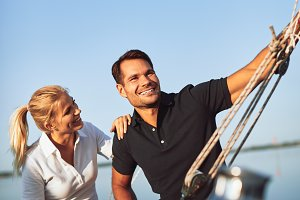 Smiling young couple sailing togethe