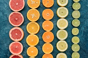 top view of citrus fruits slices in