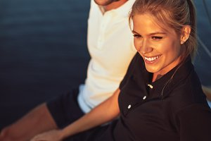 Smiling young couple enjoying the oc